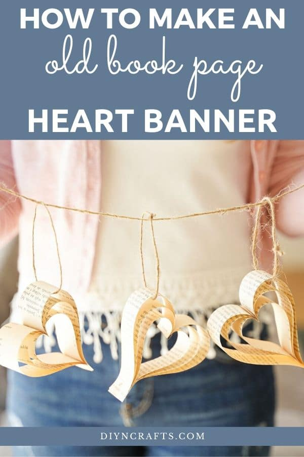 Woman holding paper heart banner
