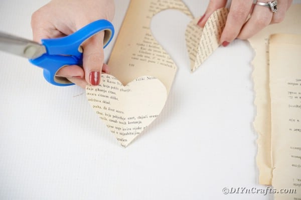 Holding a heart cut from paper