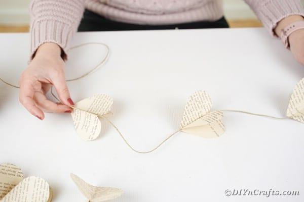 Woman holding paper heart garland