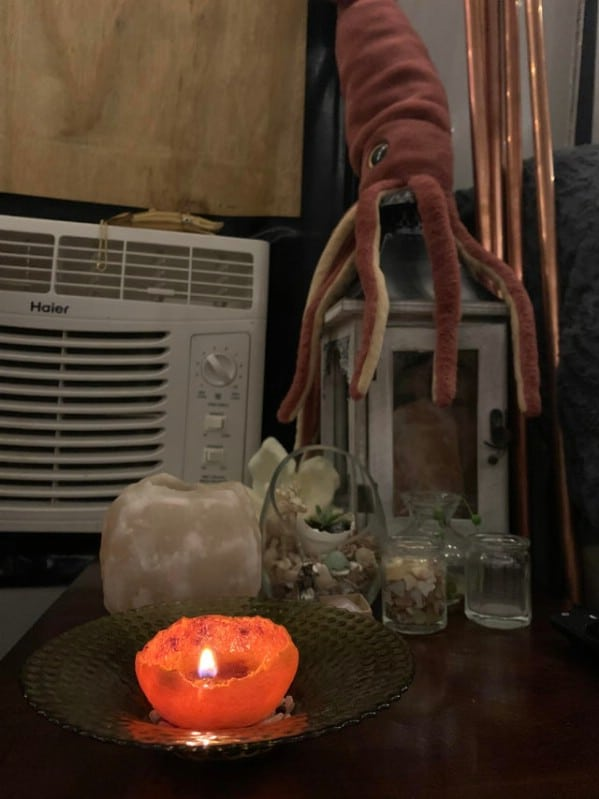 Orange peel candle burning