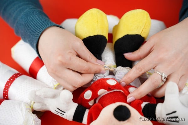 Tying minnie mouse to diaper wreath