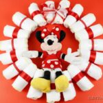 Minnie Mouse diaper wreath on red background