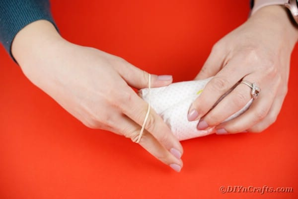 Tying a diaper with rubber band