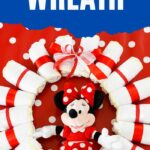 Minnie Mouse diaper wreath on red polka dot background