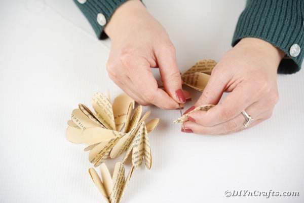 Sewing paper flower together