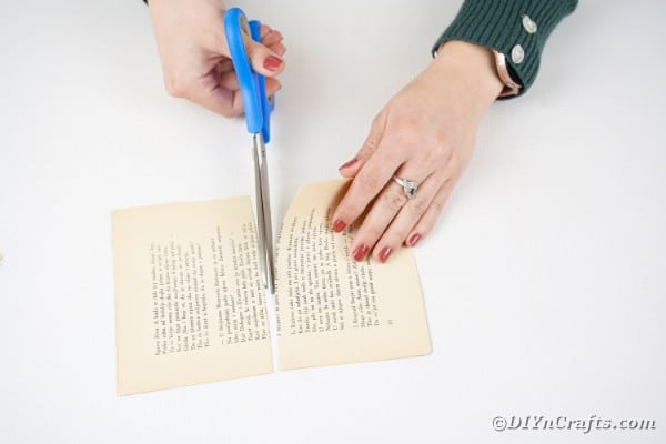 Cut book page in half