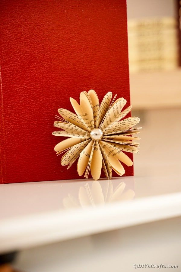 Old book page flower against red book