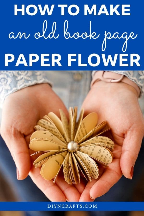 Woman holding a paper flower