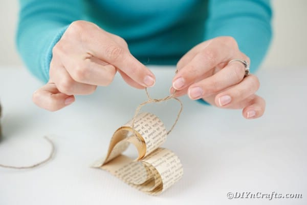 Tying a piece of twine on a paper heart