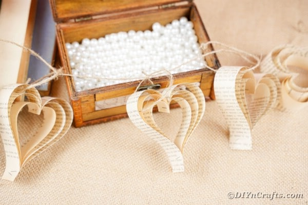 Paper heart banner laying on open chest
