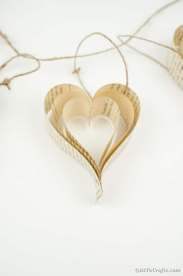 Paper heart on white surface