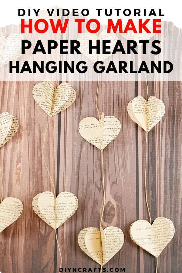 Hanging heart garland on brown wood table