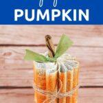 Paper pumpkin by wooden background