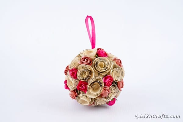 Paper rose ball on white counter