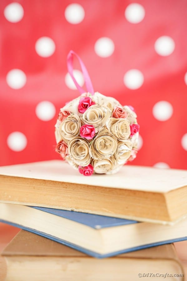 Rose paper ball on top of books