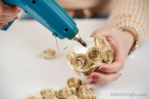 Gluing paper roses to styrofoam