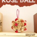Paper rose ball on top of books
