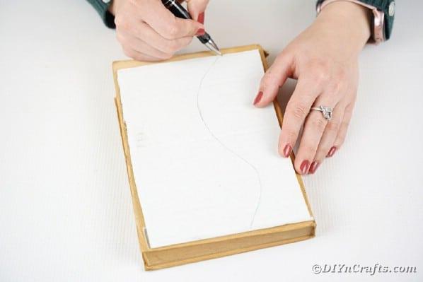 Drawing a vase shape onto cardboard