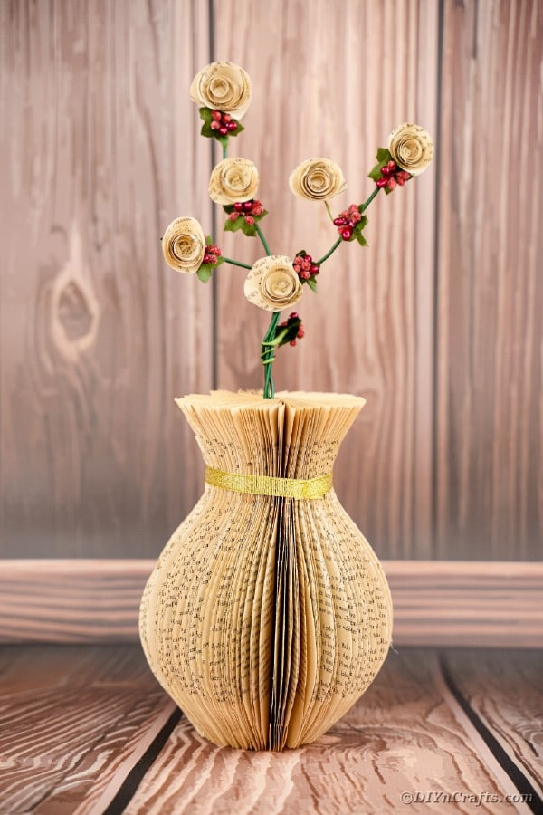 Paper vase in front of wooden background