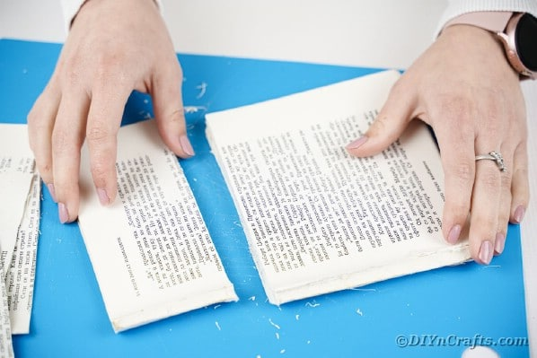 Removing book page from top of book