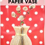 Paper vase in front of red polka dot background