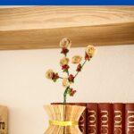 Old book page vase on shelf