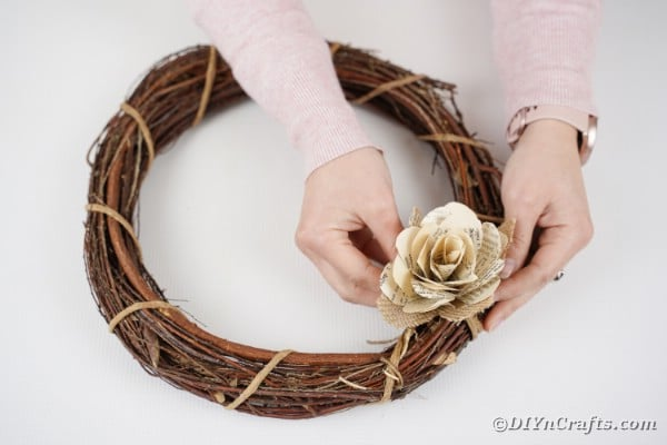Gluing paper rose on wreath
