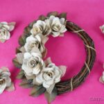 Old book page wreath on pink surface