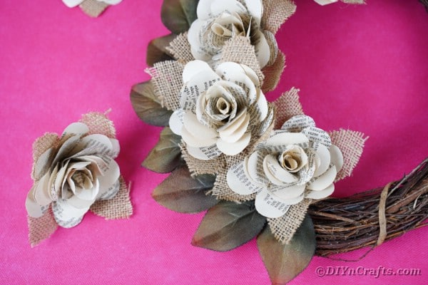 Paper rose wreath on pink table