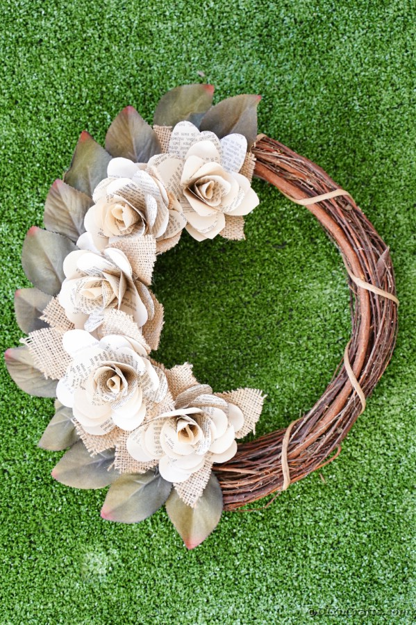 Book page wreath on grass