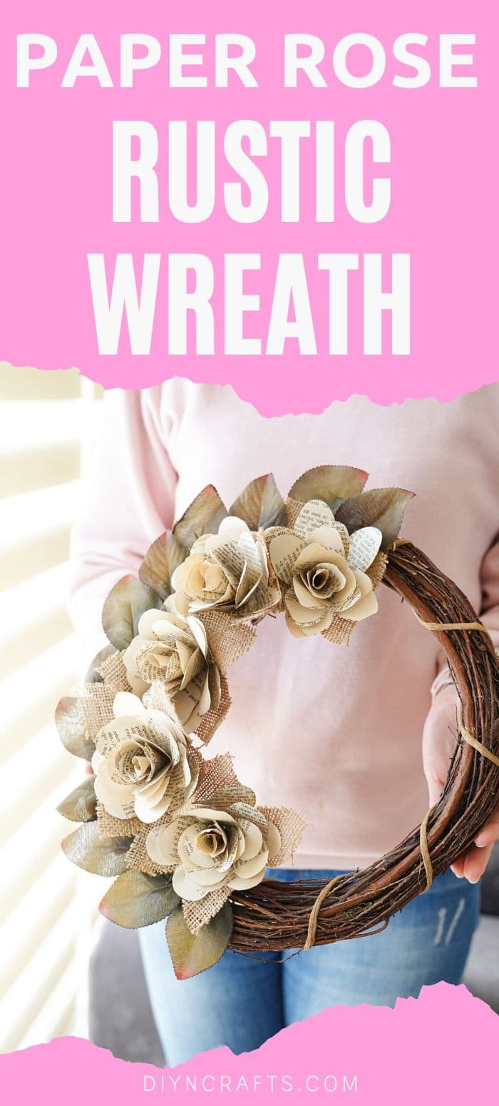 Woman holding book page wreath