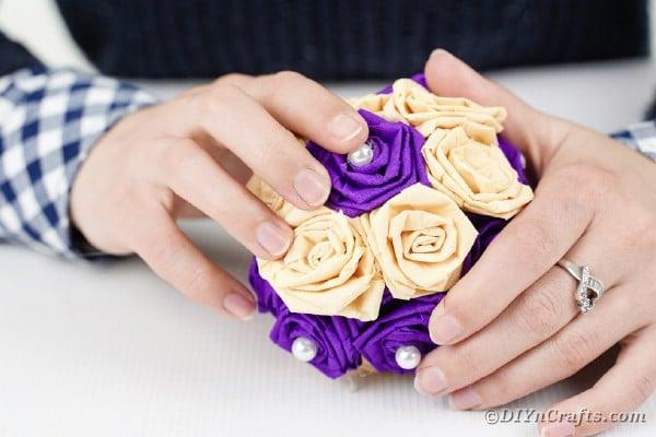 Gluing a paper rose to a Styrofoam ball