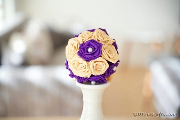 Tissue paper rose ball on candlestick