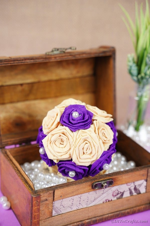 Tissue paper rose bal in box with beads