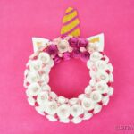 Unicorn wreath on pink wall