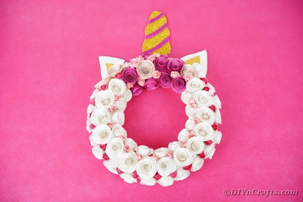 Unicorn wreath on pink wall