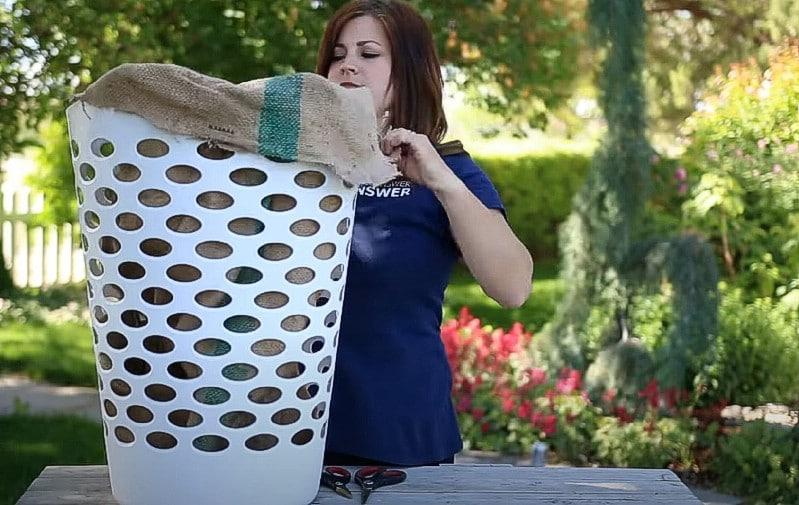 Adding and cutting a burlap sack.