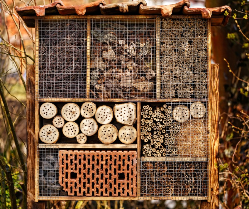 Close up of a bee hotel made from upcycled materials.