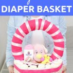 Woman holding a diaper basket gift