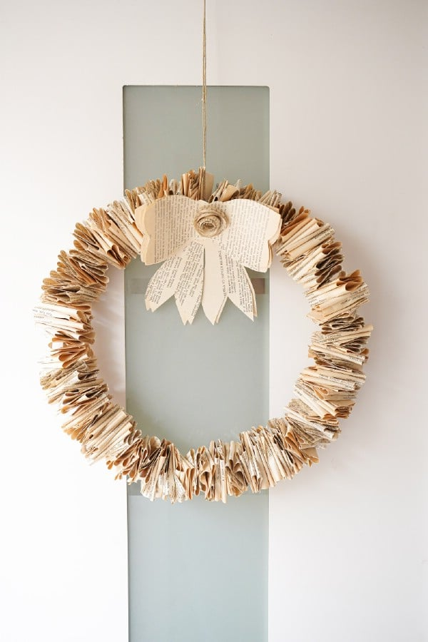 Folded book page wreath on door