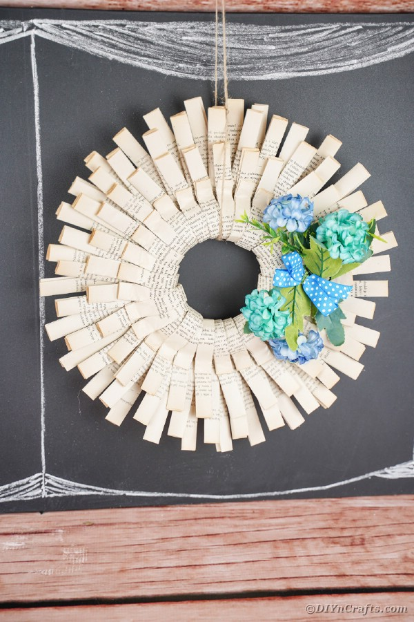 Folded paper wreath with blue flowers
