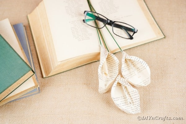 Calla lilies on book