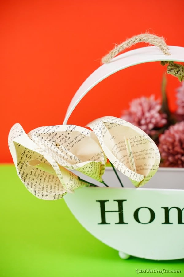 Paper flowers in basket with home on front