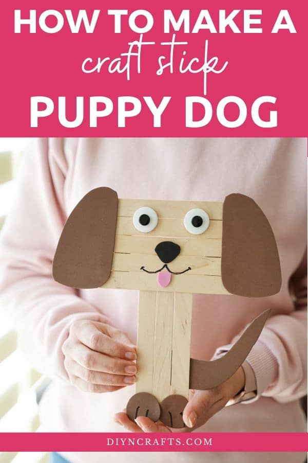 Woman holding a craft stick dog