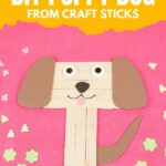 Popsicle stick puppy on pink surface