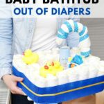 Woman holding a diaper baby bathtub