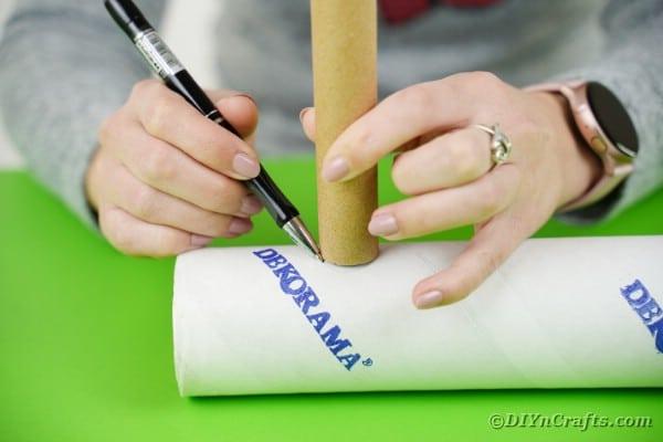 Tracing hole onto cardboard tube