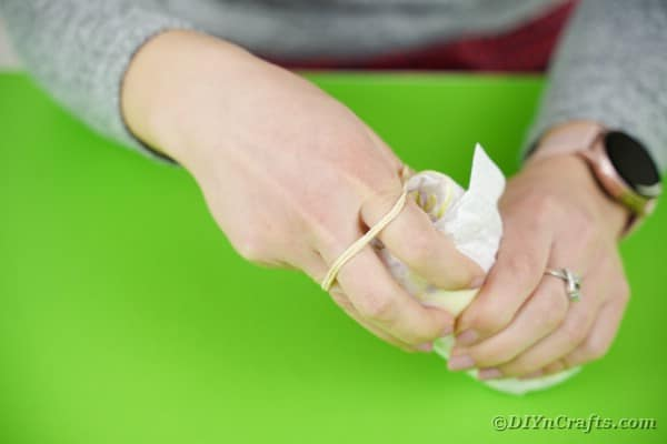 Wrapping diaper in rubber band