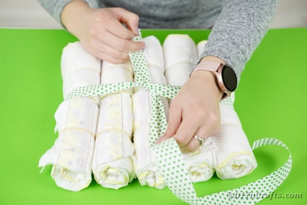 Tying ribbon onto diapers