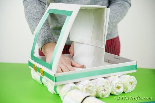 Adding cab to diaper cake base